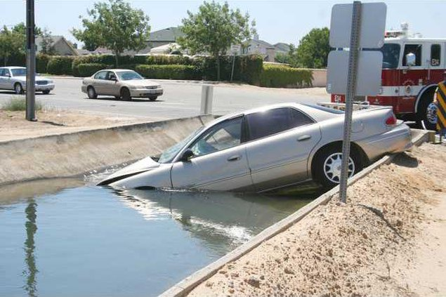 car in canal pic