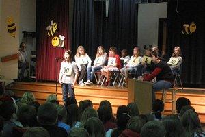 1200px-Elementary_school_spelling_bee,_December_2011.jpg