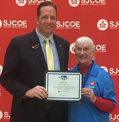 Linda McNeel recognized by Troy Brown, SJCOE.jpg